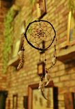 Wooden dream catcher in the evening dim light. Blue dream catcher in the evening dim light  close up Royalty Free Stock Photo