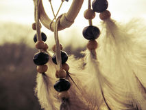 Wooden Dreamcatcher with feathers and beads. Beautiful vintage photo Stock Images