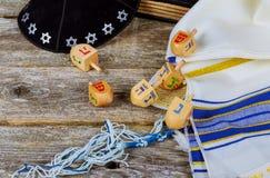 Wooden dreidel for Hanukkah on light background. Hanukkah with wooden dreidel Stock Image