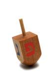 Wooden dreidel - hanukkah symbol. Isolated on white background