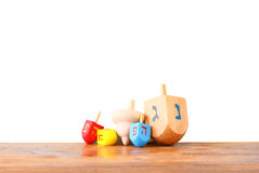 Wooden dreidels for hanukkah isolated on white background Stock Photos