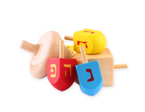 Wooden dreidels for hanukkah isolated on white background. Royalty Free Stock Photo