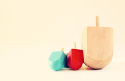 Wooden dreidels for hanukkah (spining top) . filtered image Royalty Free Stock Photo