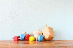 Wooden dreidels for hanukkah (spinning top) over wooden background Stock Photography