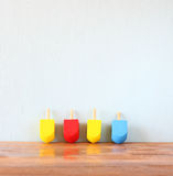Wooden dreidels for hanukkah (spinning top) over wooden background Royalty Free Stock Photo