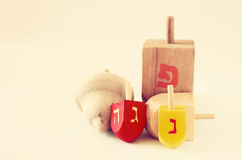 Wooden dreidels for hanukkah on wooden table Stock Photo