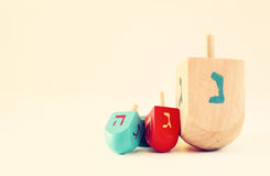 Wooden dreidels for hanukkah on wooden table. Stock Photo