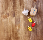 Wooden dreidels for hanukkah on wooden table. Royalty Free Stock Image