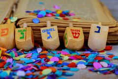 wooden dreidels spinning top for hanukkah jewish holiday over glitter background stock image