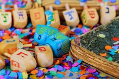 Wooden dreidels spinning top for hanukkah jewish holiday over glitter background. Jewish holiday wooden dreidels spinning top for hanukkah jewish holiday over royalty free stock image