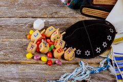 Wooden dreidels spinning top for hanukkah jewish holiday. Over glitter wood background Stock Photos