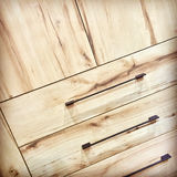 Wooden dresser with metal handles Royalty Free Stock Photography
