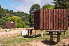 Wooden Dressing Cabins and Benches in Nature Royalty Free Stock Image