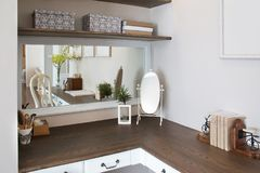 Wooden dressing table and mirror. White wall stock photos