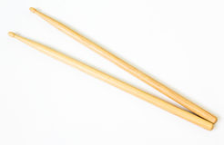 Wooden drum sticks. On a pale background Stock Photos
