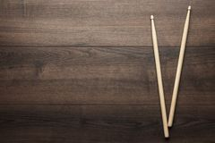 Wooden drumsticks on wooden table Stock Photography
