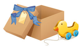 A wooden duck beside a brown box Royalty Free Stock Photography