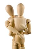 Wooden dumies hug. Isolated on white background wooden dummies hug Royalty Free Stock Photo