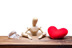 wooden dummies choose between diamond or heart, isolated on whit royalty free stock images