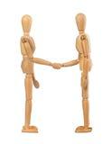 Wooden dummies shake hands Royalty Free Stock Photo