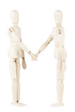 Wooden dummies shaking hands Stock Photography