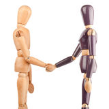 Wooden dummies shaking hands Stock Images