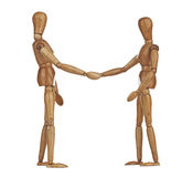 Wooden dummies shaking hands, Cooperation of business Stock Photo