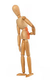 Wooden dummy with back pain Royalty Free Stock Photos