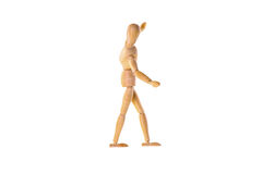 Wooden dummy in the balance Royalty Free Stock Photo