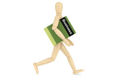 Wooden Dummy with book Royalty Free Stock Image