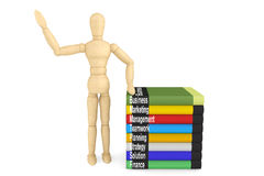 Wooden Dummy with books Stock Photos