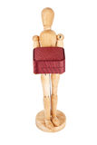 Wooden dummy carrying red gift box Royalty Free Stock Photos