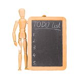 Wooden dummy with chalkboard todo list Royalty Free Stock Image