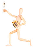 Wooden Dummy with champagne holding gift Stock Images