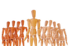 Wooden dummy character between two different teams Stock Photography