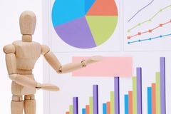 Wooden dummy with color chart documents Stock Images