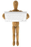 Wooden dummy with computer keyboard Royalty Free Stock Photo