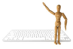 Wooden dummy with computer keyboard Stock Photo