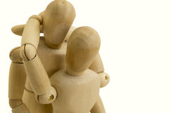 Wooden dummy couple hug concept stock image