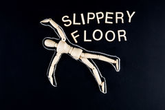 Wooden dummy figurine laying on the floor with chalk outline  an Stock Photos