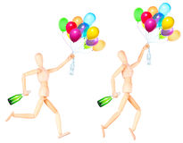 Wooden Dummy with flying balloons isolated Stock Image
