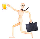 Wooden Dummy with frosty glass of light beer Royalty Free Stock Images