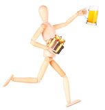 Wooden Dummy with glass of beer and gift Royalty Free Stock Photography