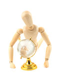Wooden dummy and glass earth globe Royalty Free Stock Photography