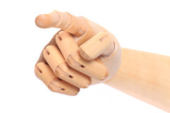 Wooden dummy hand point sign Royalty Free Stock Images