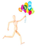 Wooden Dummy holding flying balloons isolated Stock Image