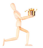 Wooden Dummy holding gift with ribbon Stock Images