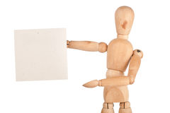 Wooden dummy holding paper Royalty Free Stock Image