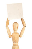 Wooden dummy holding paper Stock Image