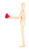 Wooden Dummy holding red heart. Isolated. Health insurance or love concept Royalty Free Stock Photos